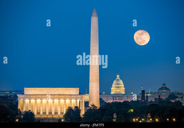 Supermoon above three iconic monuments: Lincoln Memorial, Washington Monument and Capitol Building in Washington - Stock Image