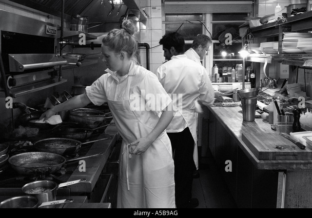 Restaurant Kitchen Staff restaurant kitchen staff busy work stock photos & restaurant