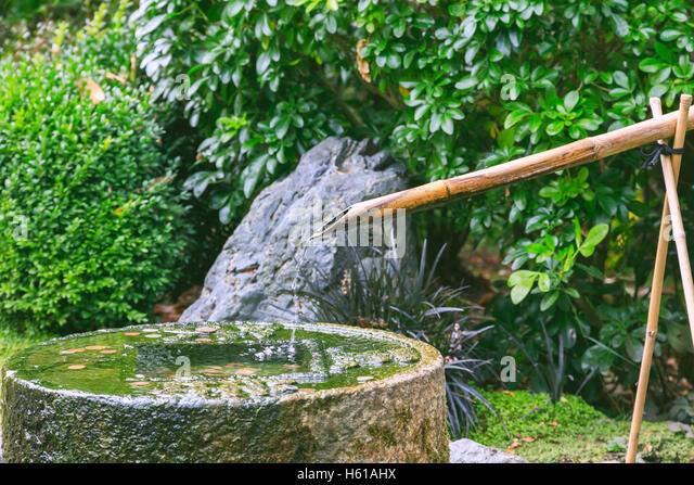 Bamboo water feature stock photos bamboo water feature for Bamboo water feature
