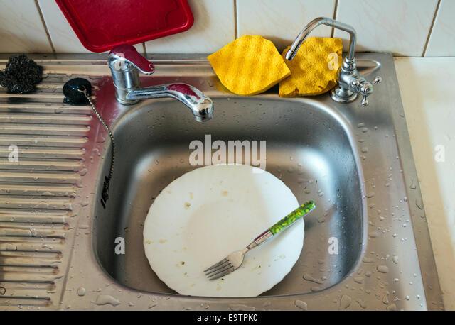 Kitchen Sink With Dishes kitchen sink unwashed dishes stock photos & kitchen sink unwashed