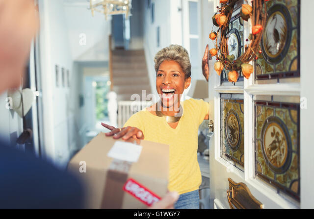 Enthusiastic woman receiving package delivery at front door - Stock Image  sc 1 st  Alamy & Package Delivery Door Stock Photos \u0026 Package Delivery Door Stock ...