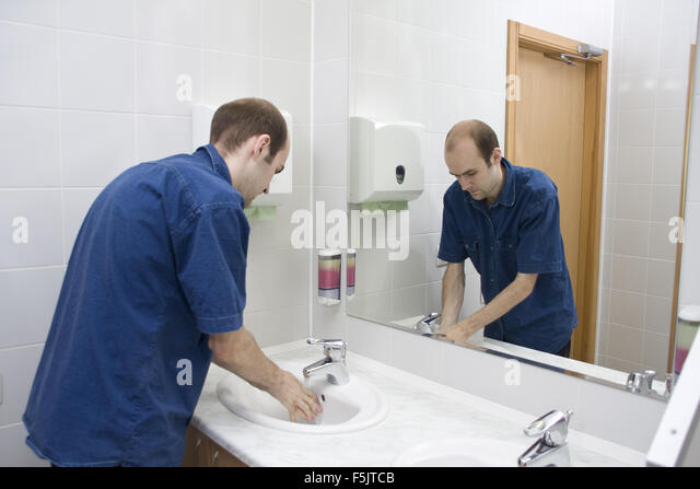Public Bathroom Mirror public bathroom mirror man stock photos & public bathroom mirror