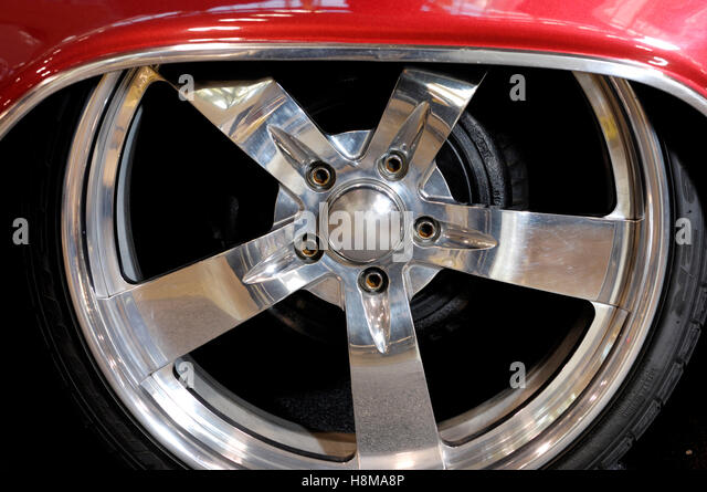 shiny chromed custom classic car wheel stock image