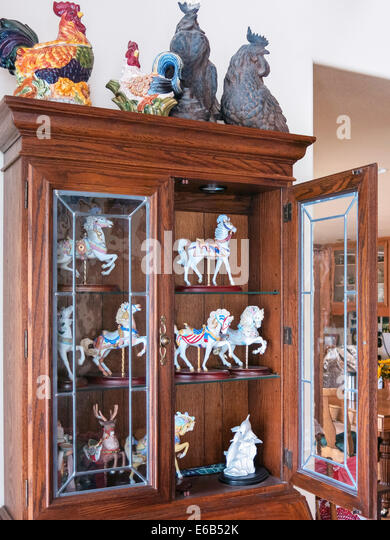 Curio Cabinet With Collectible Carousel Animals, USA   Stock Image
