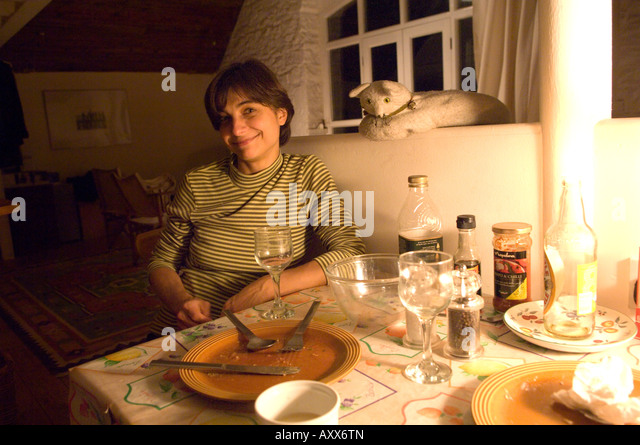 young belarrussian woman immigrant relaxes after a meal at a friends