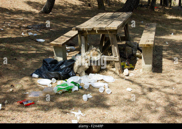 [Image: wooden-picnic-table-with-garbage-strewn-near-f2h4rp.jpg]