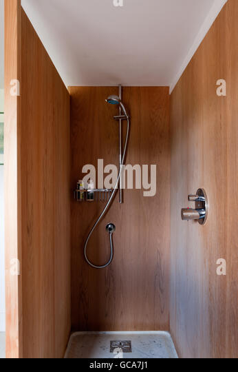 Teak Panelled Shower Unit With Marble Shower Tray   Stock Image