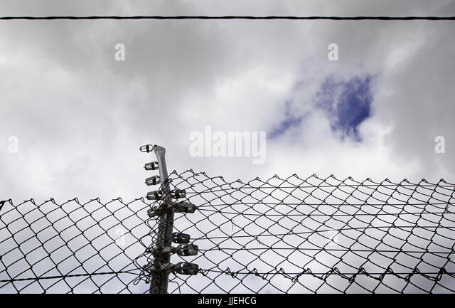 Looking Through Barbed Wire Fence Stock Photos & Looking Through ...