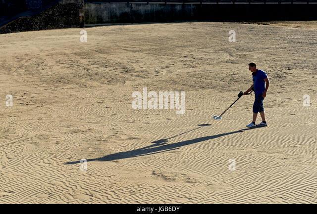 Jew Detector: Man Searching Beach Metal Detector Stock Photos & Man