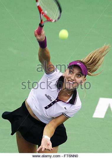 Elena Vesnina of Russia returns the ball during her semi final match ...