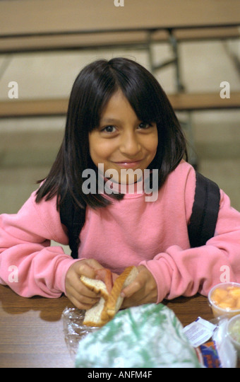 Mideastern american student age 10 eating lunch at summer school stock