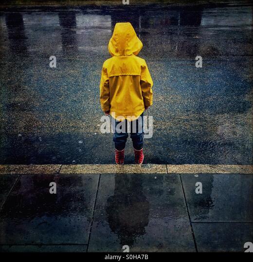 child standing in the rain stock photo 310167855 alamy