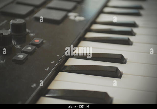Piano or electone midi keyboard, electronic musical synthesizer white and black key. Vintage effect, instagram filter - Stock Image
