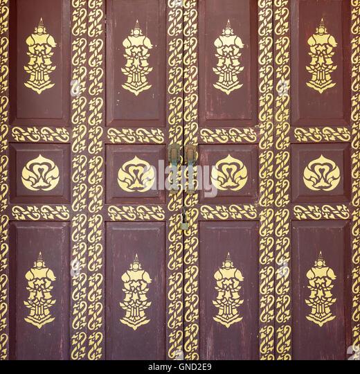 Native Thai style of pattern on door temple - Stock Image