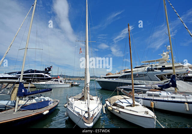 Small Sailing Boats And Luxury Yachts In Port Of Saint Tropez Provence Cote D