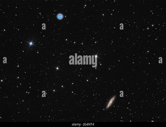 Planetary nebula M97 (Owl Nebula) and galaxy M108 in constellation Ursa Major - Stock Image