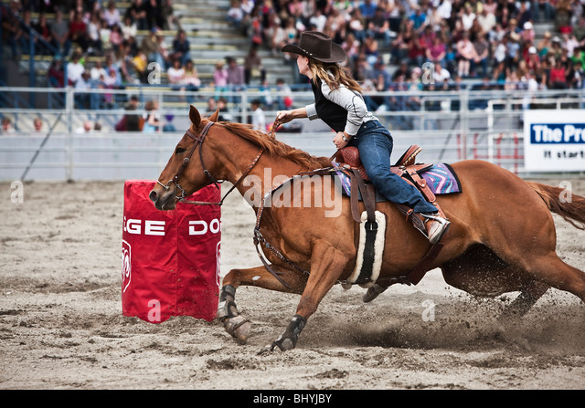 Cowgirl riding bucking horse