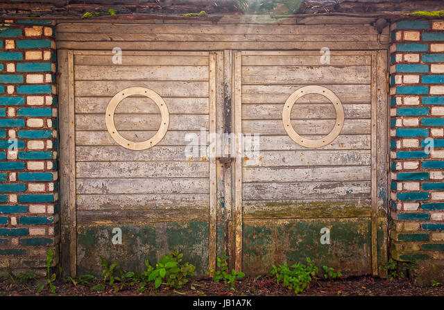 Old garage doors look like a big-eyed face. This old building is in & Old Garage Doors Stock Photos \u0026 Old Garage Doors Stock Images - Alamy Pezcame.Com
