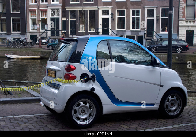 Electric Cars Charging Stock Photos Electric Cars Charging Stock