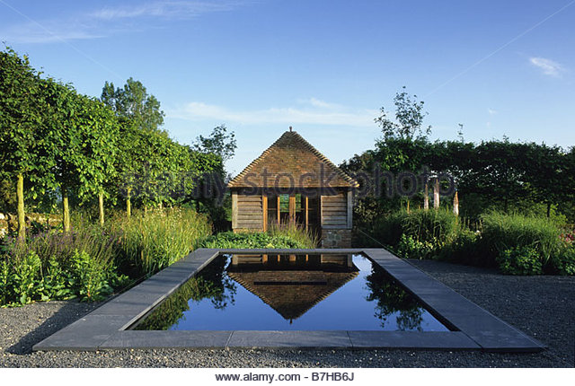 private garden sussex design fiona lawrenson formal reflecting pool with garden building stock image