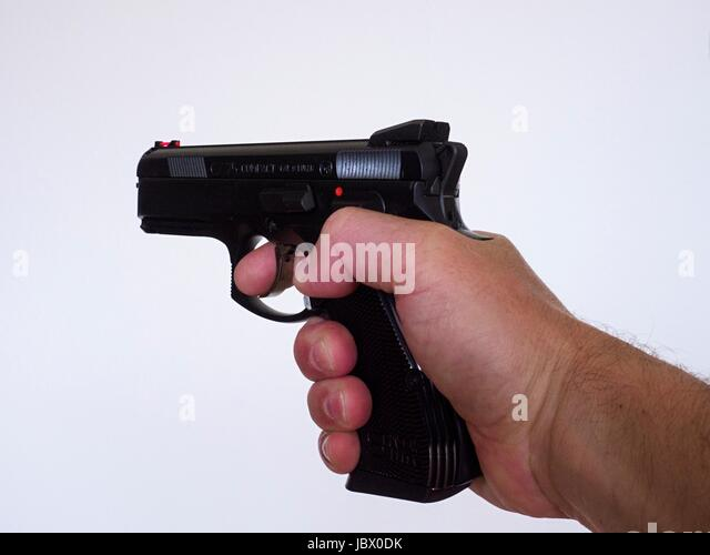 Pistol, hand, finger, trigger - Stock Image