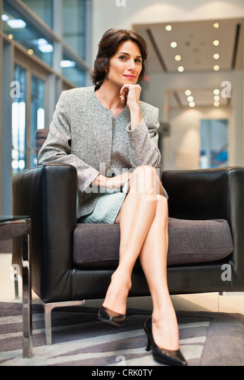 Portrait Confident Businesswoman Legs Crossed Stock Photos