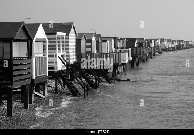 Black and white image of beach huts at thorpe bay near southend on