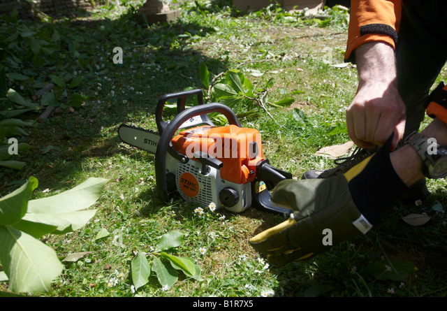 How to put chain back on stihl chainsaw image collections wiring putting chain back on stock photos putting chain back on stock man in full protective stihl keyboard keysfo Image collections