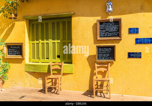 calvi corsica island jun 28 2015 chairs in front of traditional restaurant - Yellow Restaurant 2015