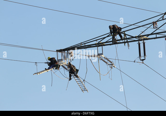 Rendsburg, Germany, Workers Replace Insulators On High Voltage Pylons    Stock Image