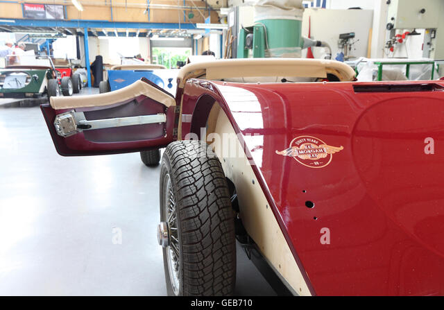 80th anniversary edition of morgan plus 4 sportscar in the trim shop at morgans malvern factory