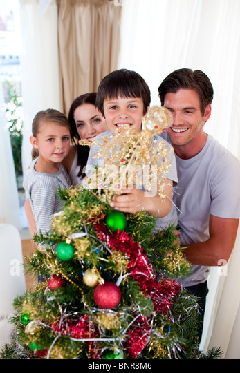 People Decorating For Christmas christmas tree decoration angel stock photos & christmas tree