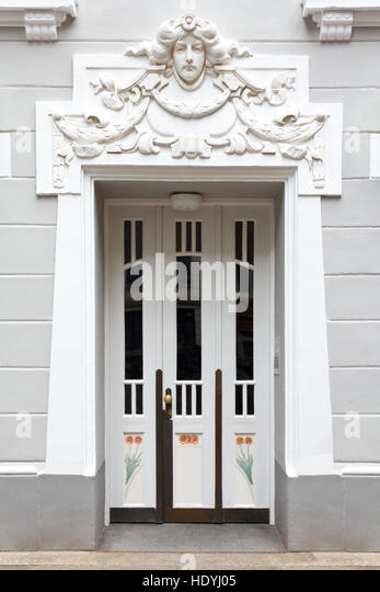 Entrance Door Of An Historic Building With Stucco In Art Nouveau Style,  Sculpture Of A