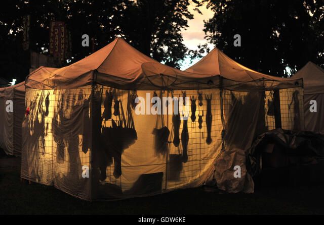 Shadows of products for sale inside a tent in a night market in London Ontario & Night Tent Shadows Stock Photos u0026 Night Tent Shadows Stock Images ...