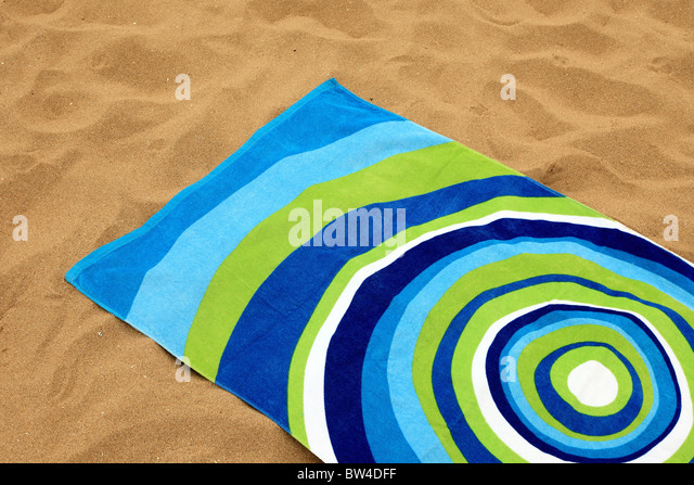 Beach Towel Laid On Golden Sands   Stock Image