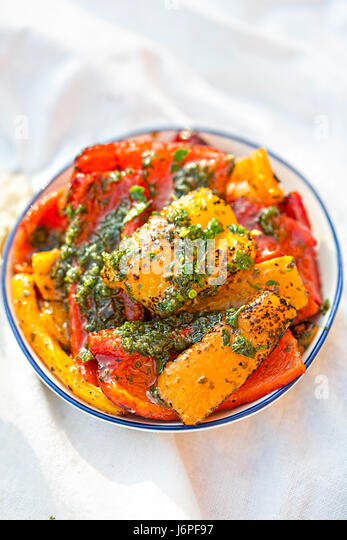 Antipasti - red, green and red peppers with green pesto - Stock Image