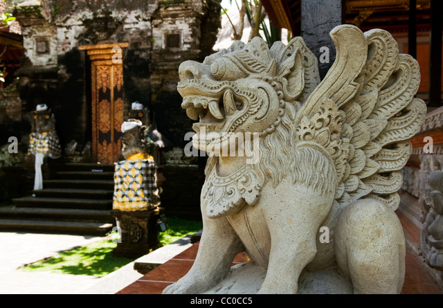 Lion statue entrance temple puri stock photos