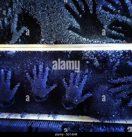 many-hands-press-on-large-blue-pin-art-w