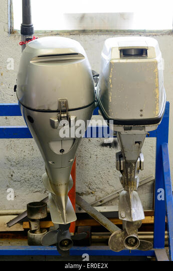 Outboard motor repair stock photos outboard motor repair for Boat motor repair shops