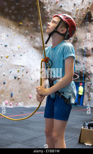 a young boy climbing at an indoor climbing centre wall eybb1w child indoor climbing wall stock photos & child indoor climbing wall
