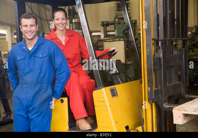 two warehouse workers with forklift stock image - Warehouse Forklift Operator Jobs