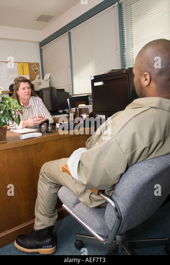juvenile inmate talking to counsellor correctional youth facility in