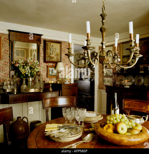 Dining Room With Fruit Bowl In Traditional English Country Cottage