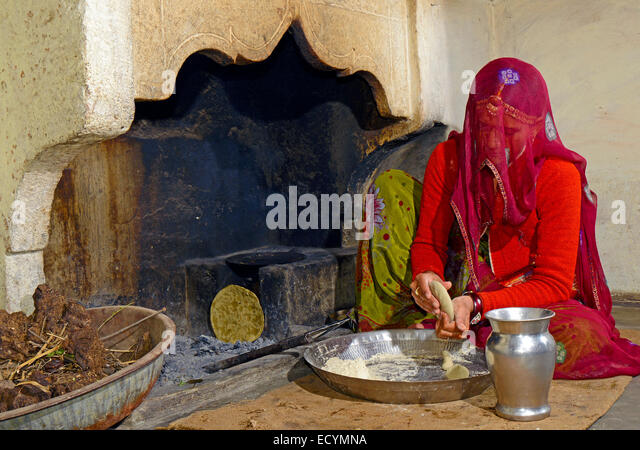 Indian lady cooking stock photos indian lady cooking for Traditional indian kitchen pictures