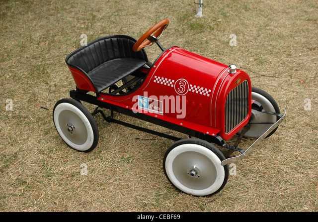 old pedal car for children red vintage toy car stock image