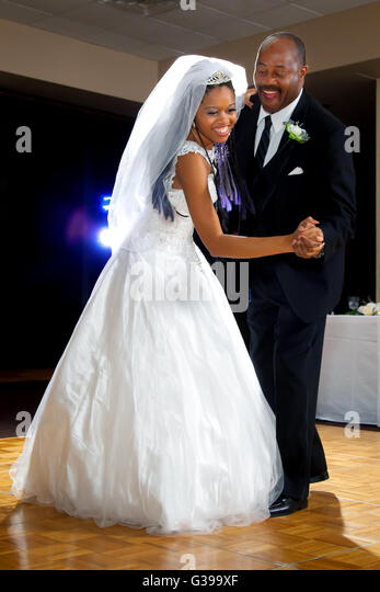 An African American Bride Dances With Her Dad During The Father Daughter Dance At Wedding