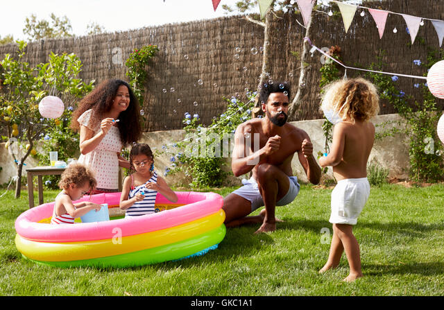 Home garden paddling pool stock photos home garden for Family garden pool