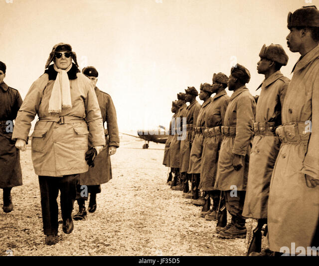 General of the Army Douglas MacArthur is shown inspecting troops of the 24th Inf. on his arrival at Kimpo airfield - Stock Image