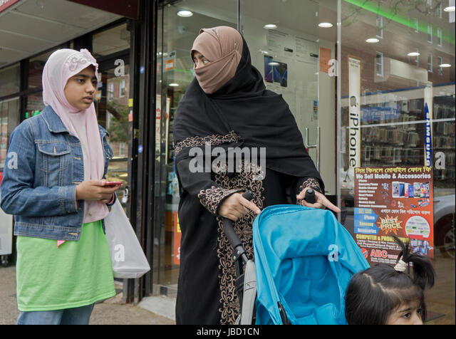 Muslim women - presumable a family - walking on 37th Ave in Jackson Heights, Queens, New York City - Stock Image