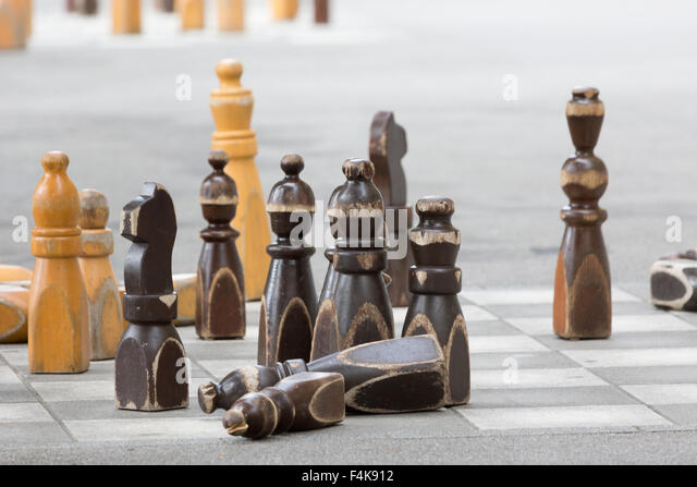a photograph of some large chess pieces outside the swiss parliament building bundeshaus in